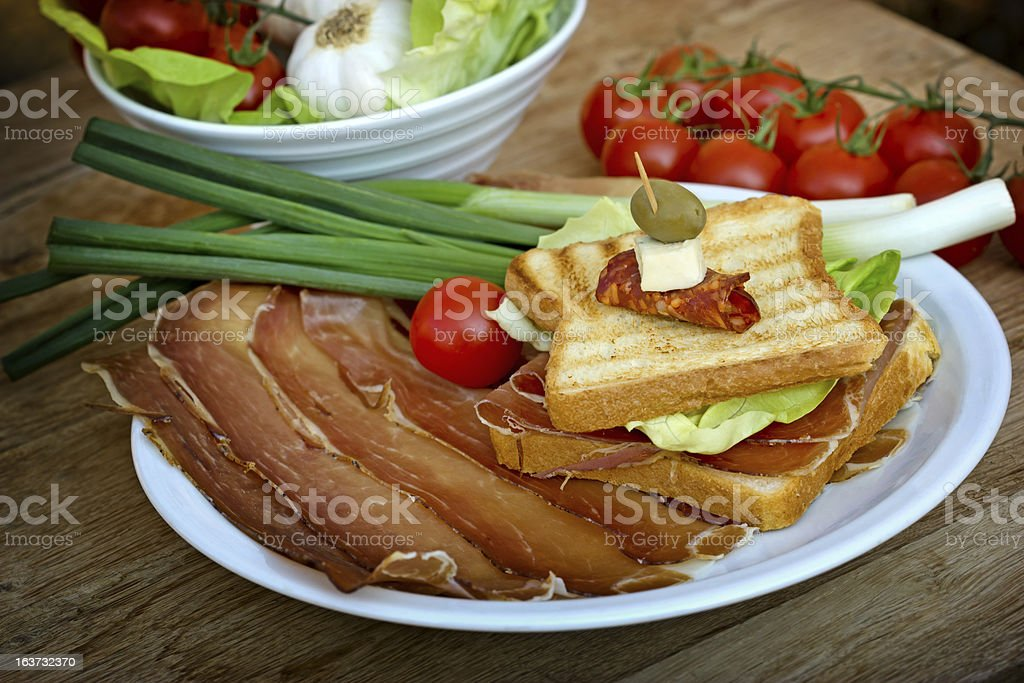 Sandwich with ham - prosciutto royalty-free stock photo