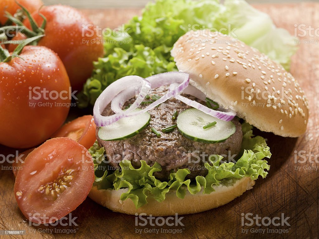 sandwich with hamburger and fried potatoes royalty-free stock photo