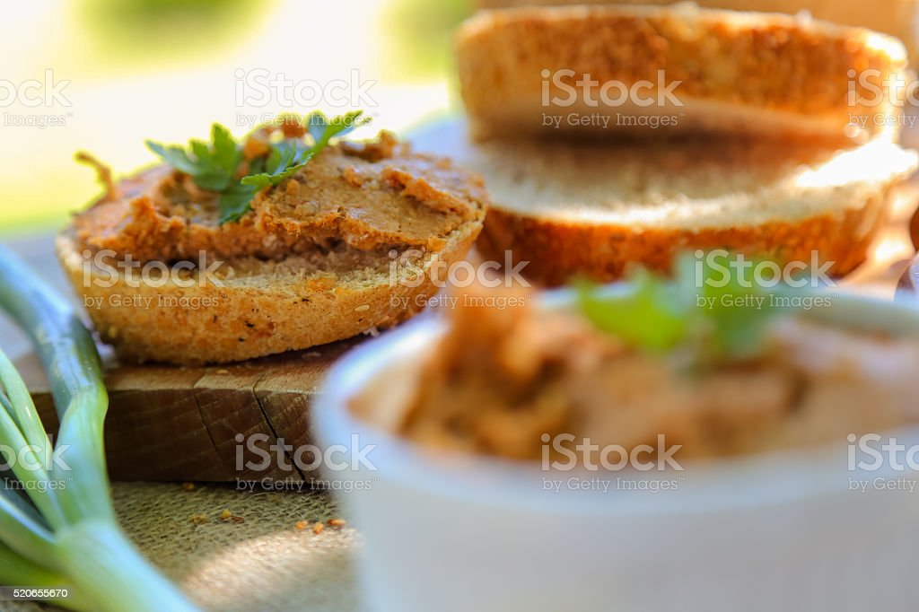 Sandwich with homemade liver pate and green onion stock photo
