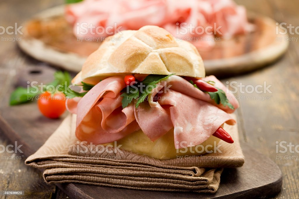 Sandwich with Mortadella and red peppers stock photo