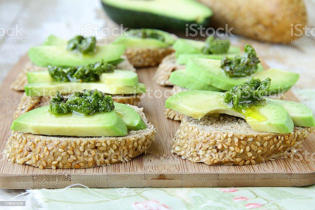 Sandwich with pesto sauce and avocado royalty-free stock photo