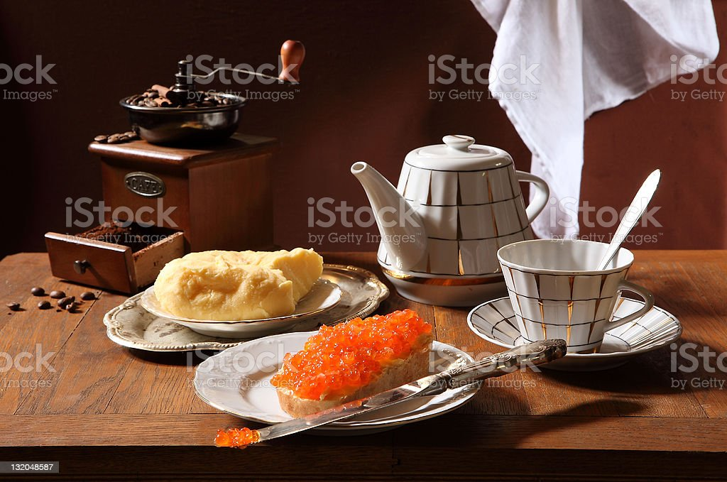 Sandwich with red caviar, butter and coffee stock photo