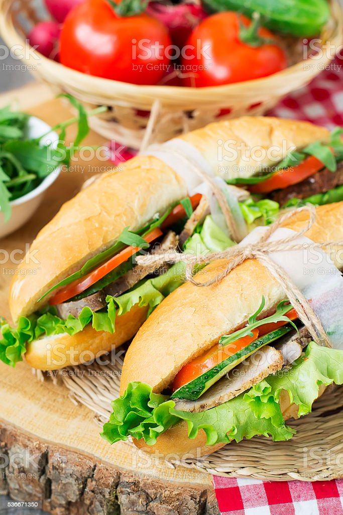 Sandwich with roasted meat and vegetables stock photo