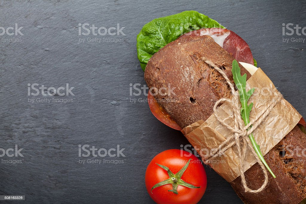 Sandwich with salad, ham, cheese and tomatoes stock photo