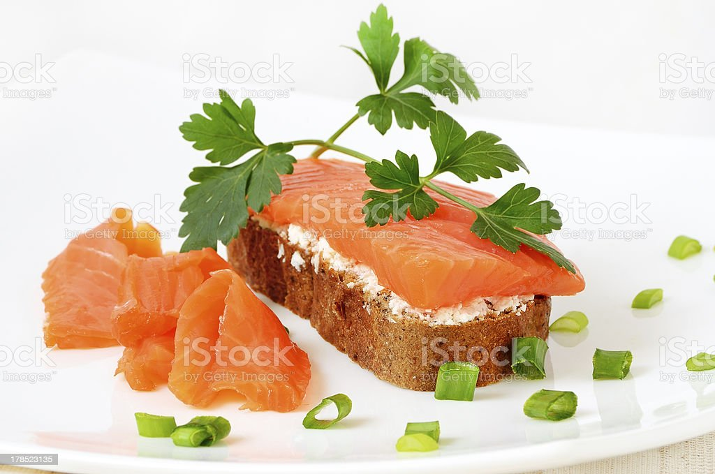 Sandwich with salmon and parsley royalty-free stock photo