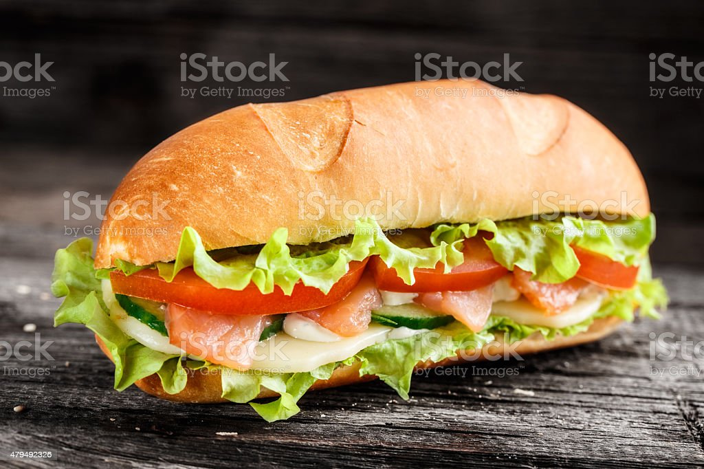 Sandwich with salmon and vegetables stock photo
