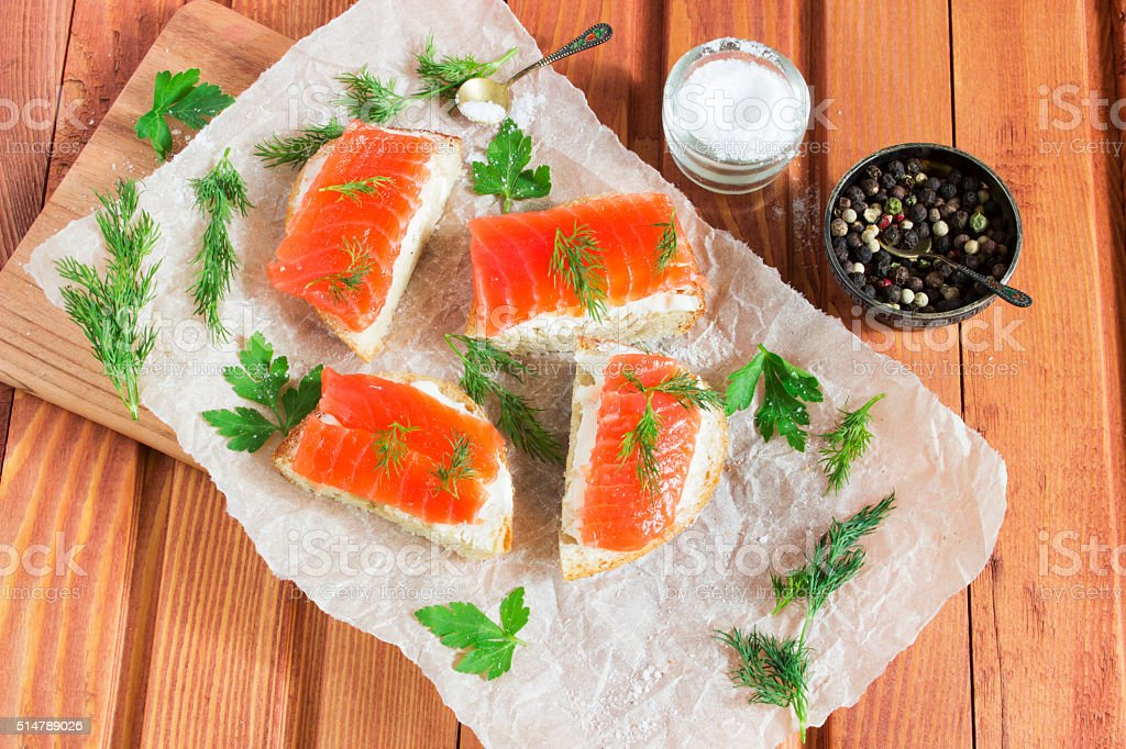 Sandwich with salted salmon and butter and spices stock photo