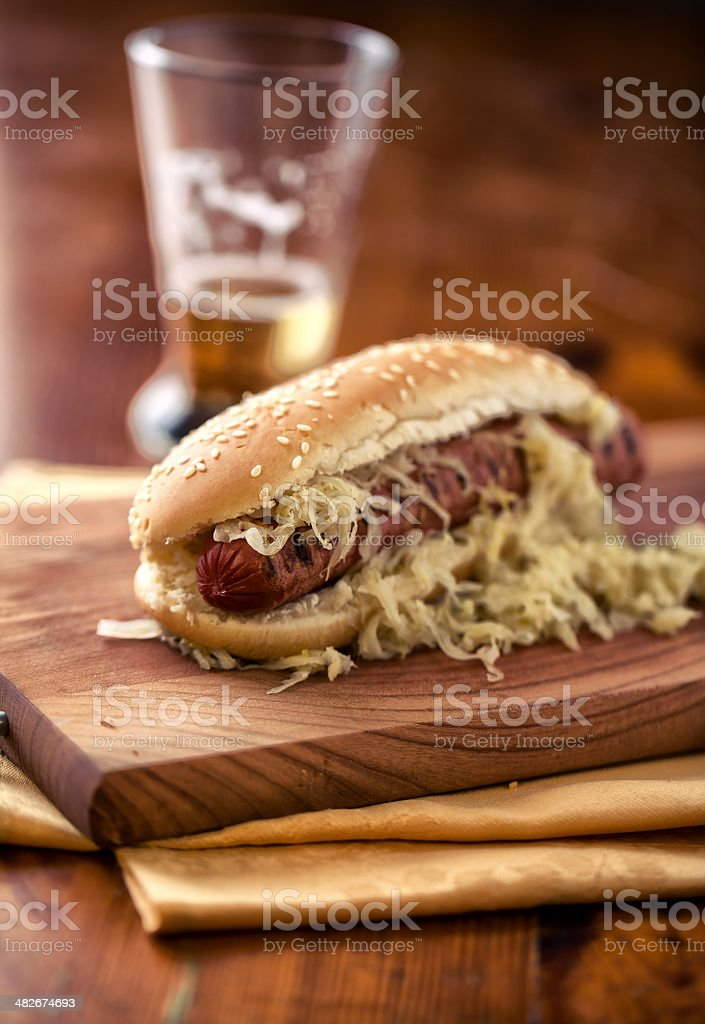 Sandwich with sausage and sauerkraut stock photo
