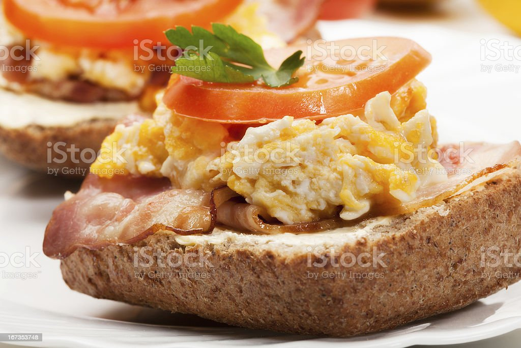 Sandwich with scrambled eggs and bacon royalty-free stock photo