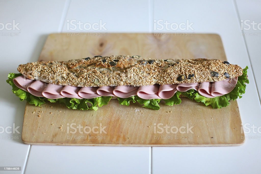 Sandwich with seeds, salami and salad royalty-free stock photo