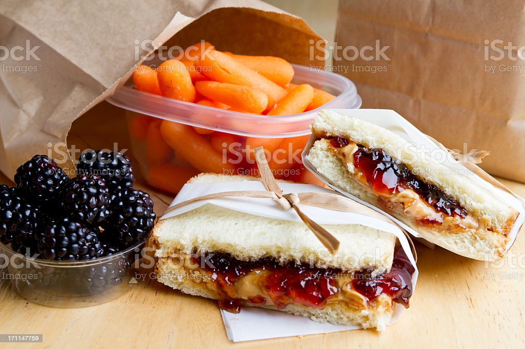 PB&J sandwich with some blueberries and carrots stock photo