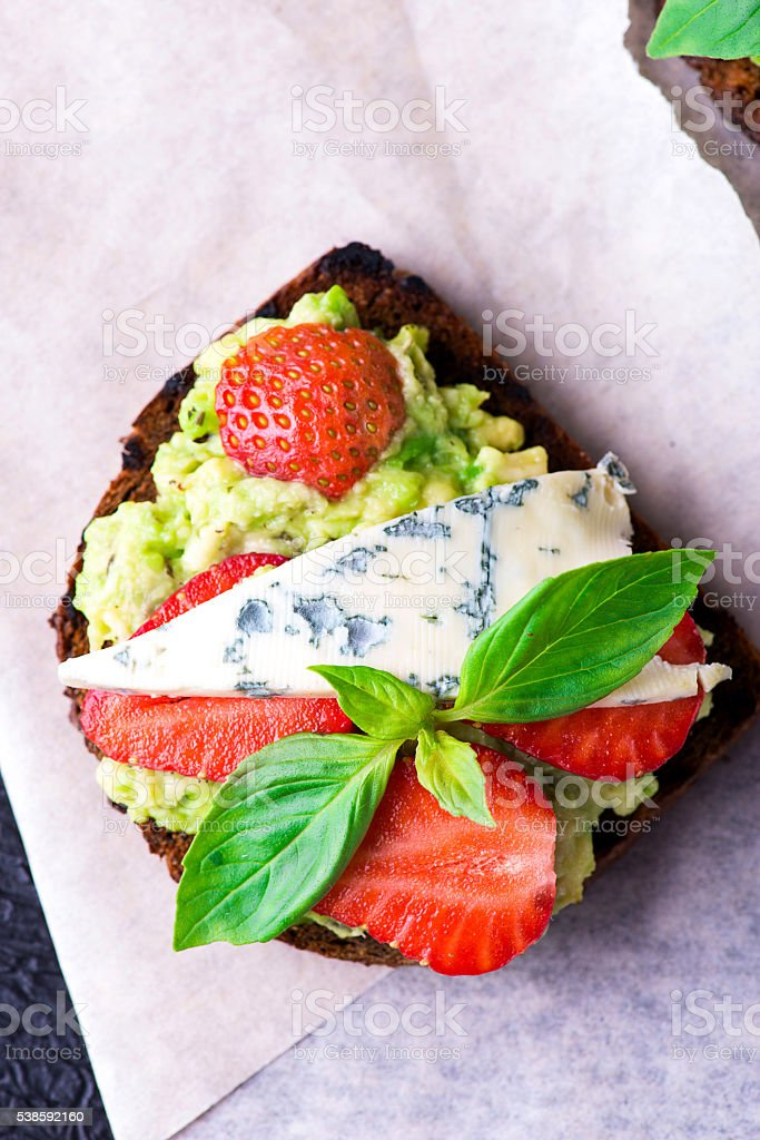 Sandwich with strawberry on white paper stock photo