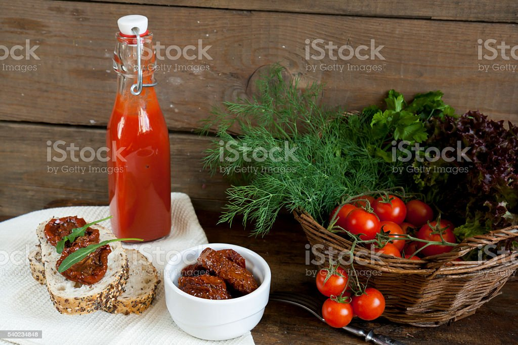 Sandwich with sun-dried tomatoes and arugula, sun-dried tomatoes, fresh tomatoes stock photo