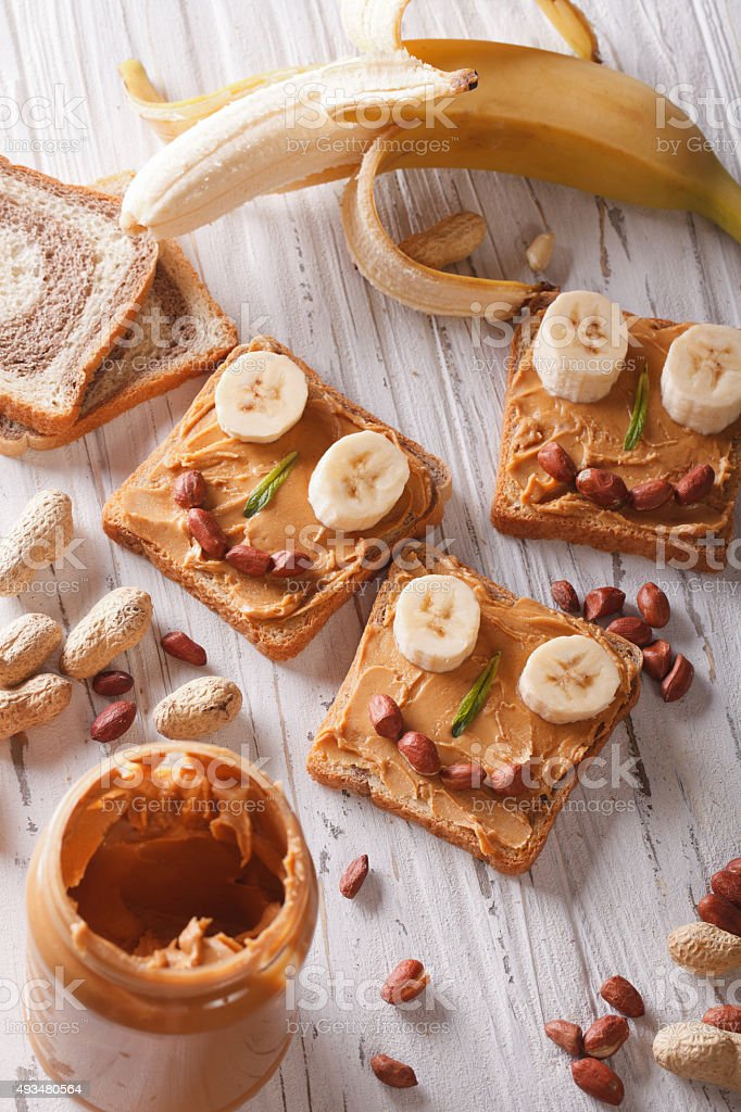Sandwiches for children with peanut butter vertical top view stock photo