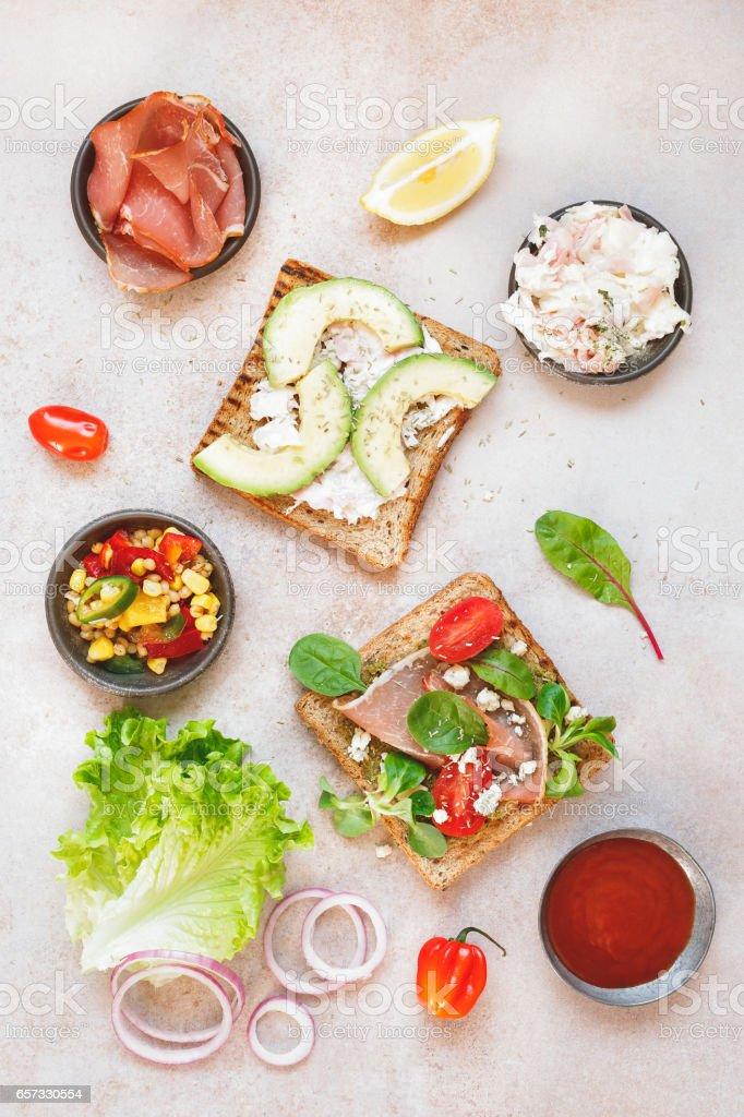 Sandwiches from whole grain bread with ingredients stock photo