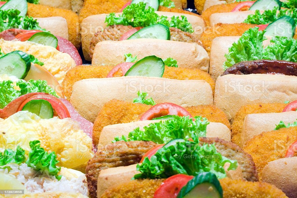 sandwiches in a row filled with salad, background royalty-free stock photo