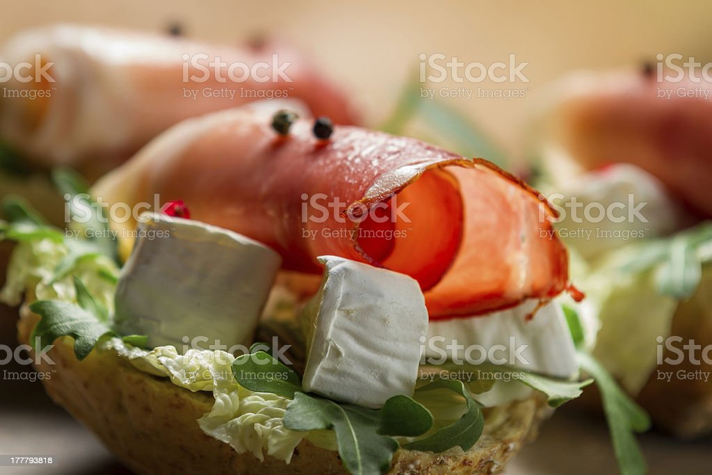 Sandwiches made of parma ham and brie cheese royalty-free stock photo