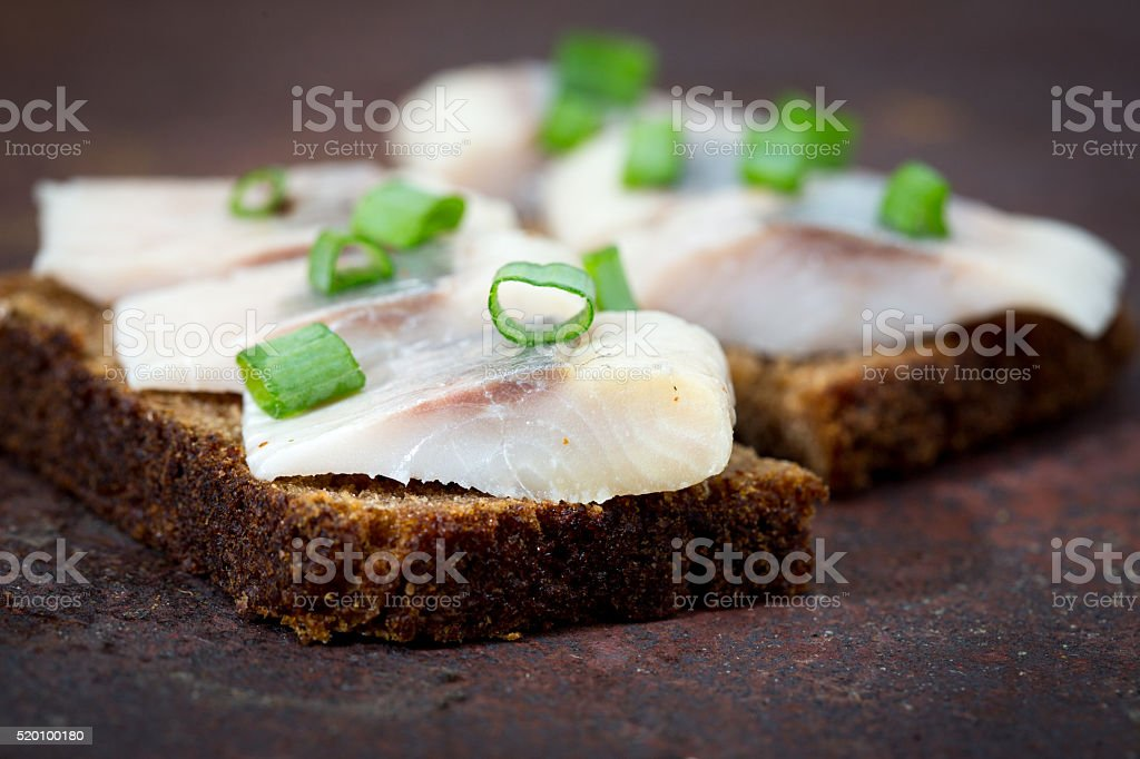 Sandwiches of rye bread and herring. stock photo