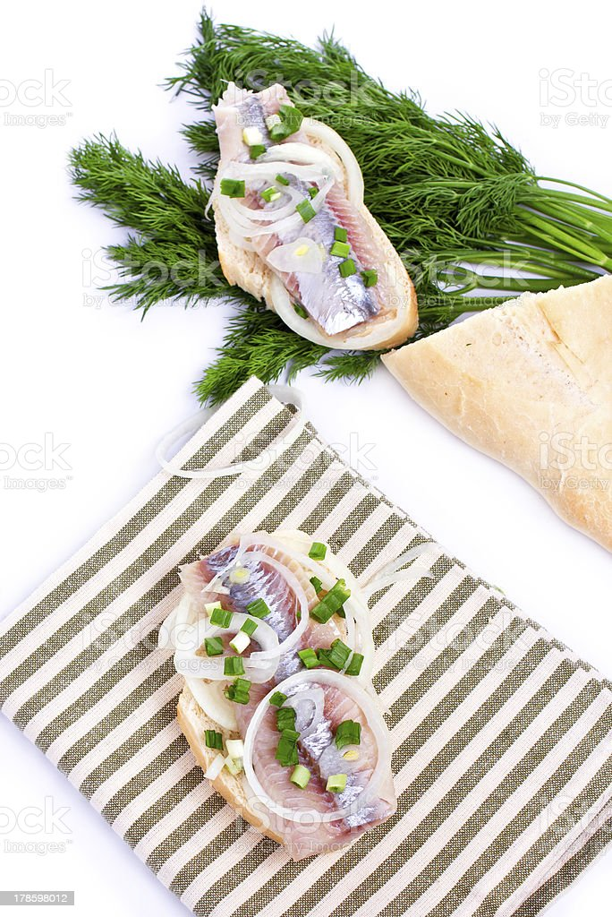 Sandwiches of white bread with herring, onions royalty-free stock photo