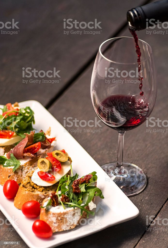 Sandwiches on a plate and wine splash royalty-free stock photo