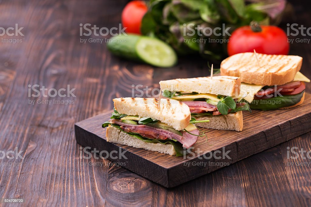 Sandwiches with bacon, cheese, greens and pea sprouts stock photo