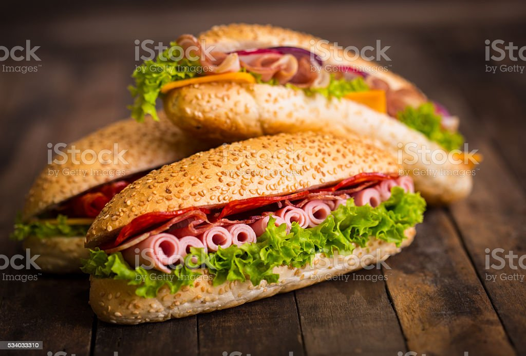 Sandwiches with ham and cheese on the table stock photo