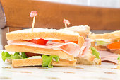 sandwiches with ham and tomato salad