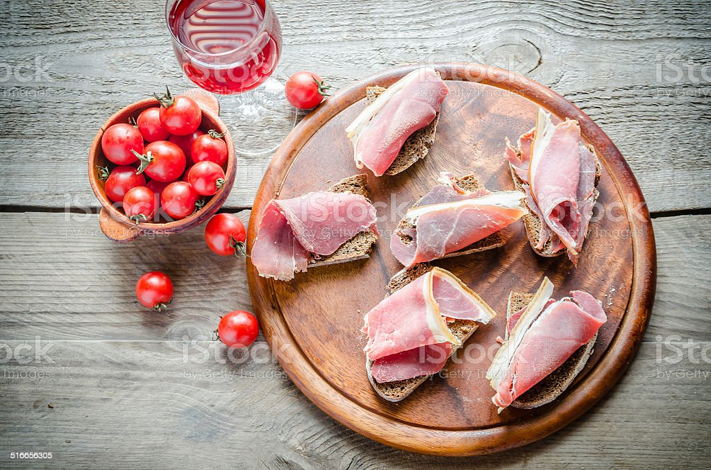 Sandwiches with italian ham on the wooden board stock photo