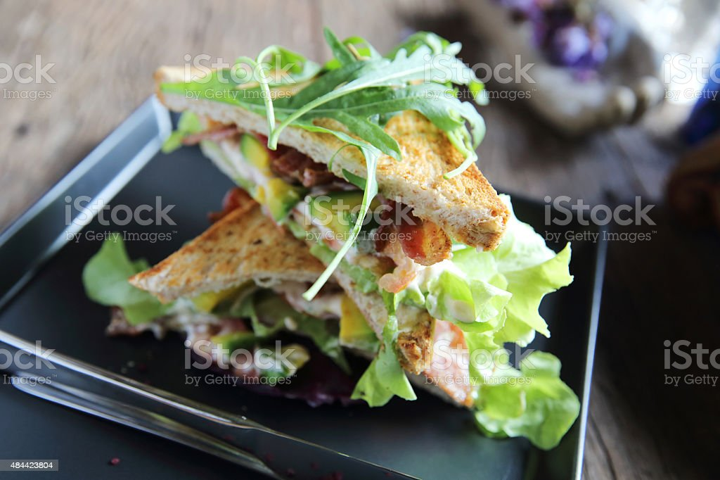 Sandwiches with meet and vegetables on wood background stock photo