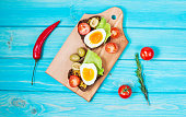 Sandwiches with olive, quail eggs, cherry tomatoes and salad on