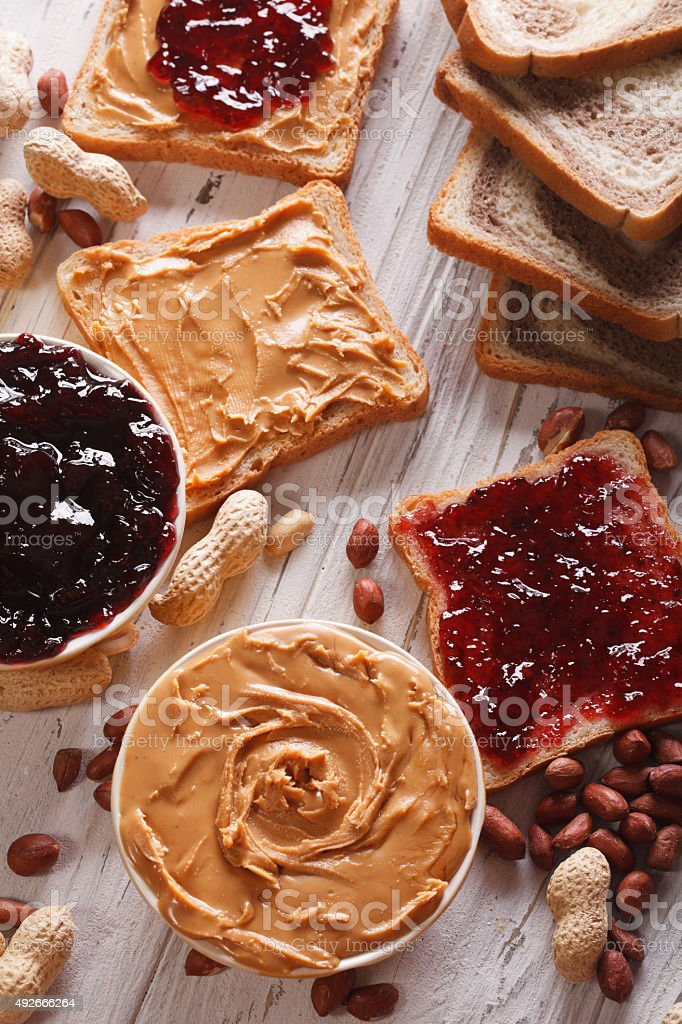 Sandwiches with peanut butter and jelly vertical stock photo
