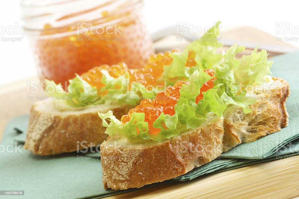 Sandwiches with red caviar and green salad royalty-free stock photo