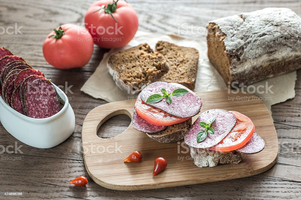 Sandwiches with salami and tomatoes stock photo