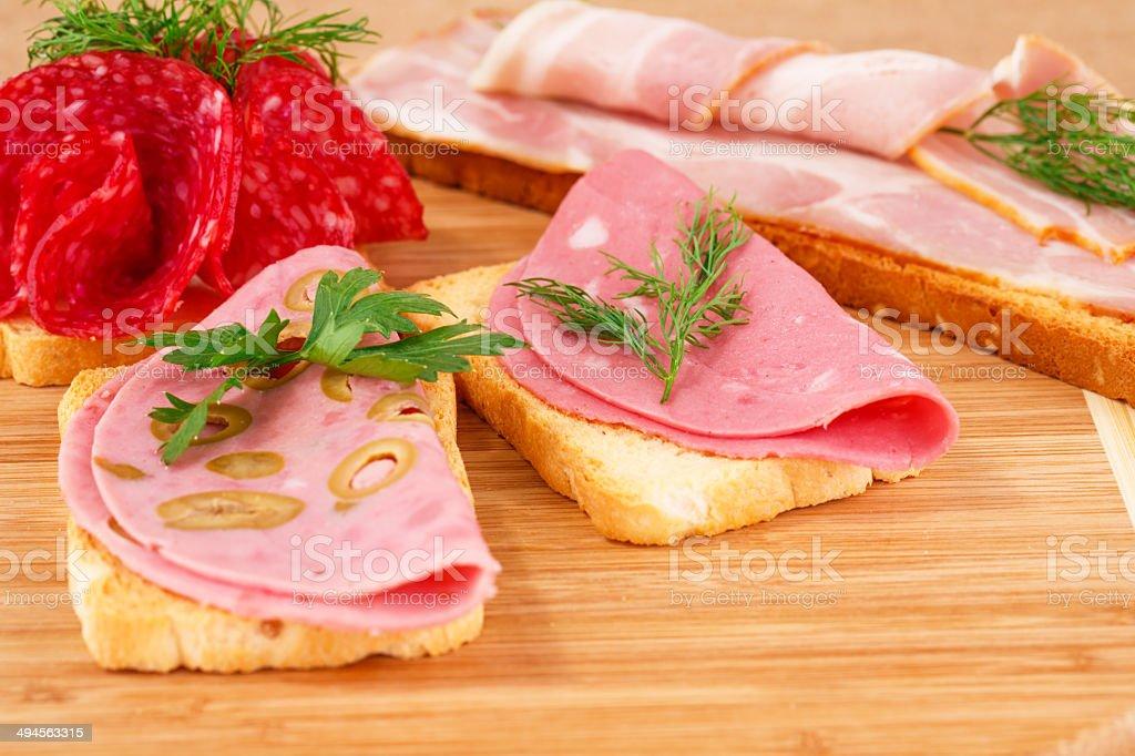 Sandwiches with salami, bacon and mortadella stock photo