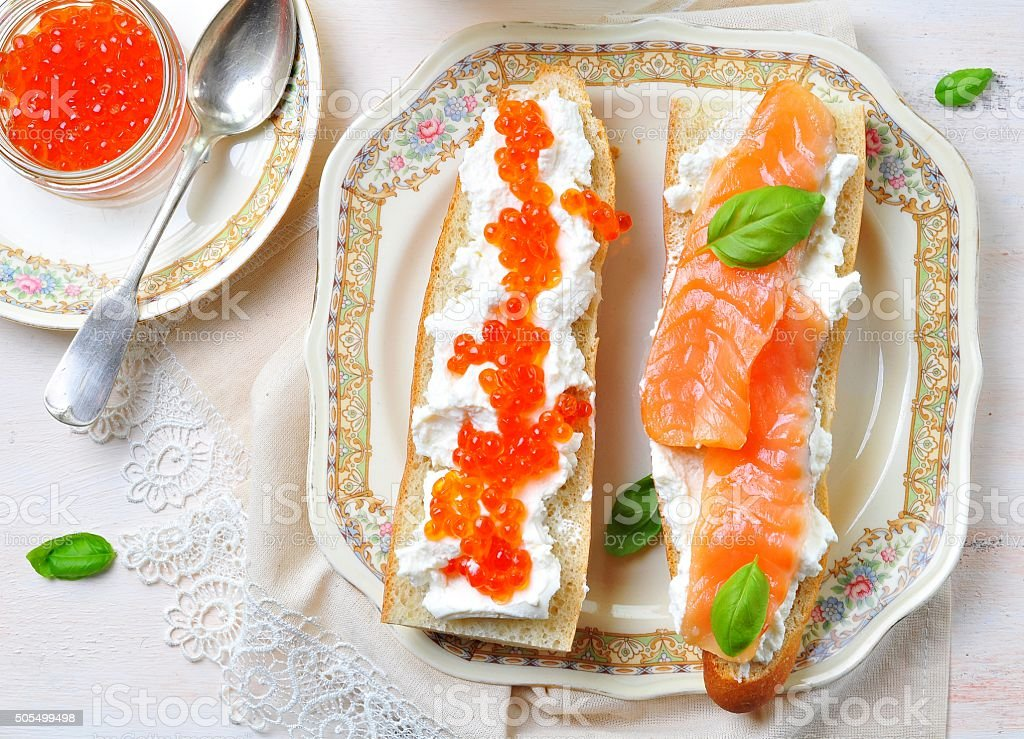 sandwiches with soft cheese smoked salmon and caviar stock photo
