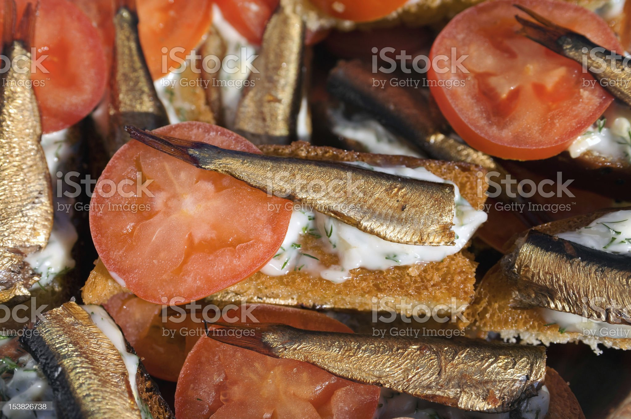 Sandwiches with sprats and tomatoes royalty-free stock photo