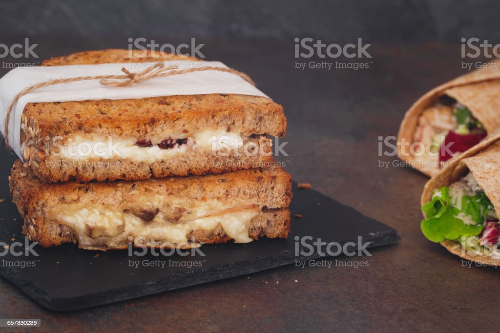 Sandwiches wrapped in paper and tortilla wraps, close up stock photo
