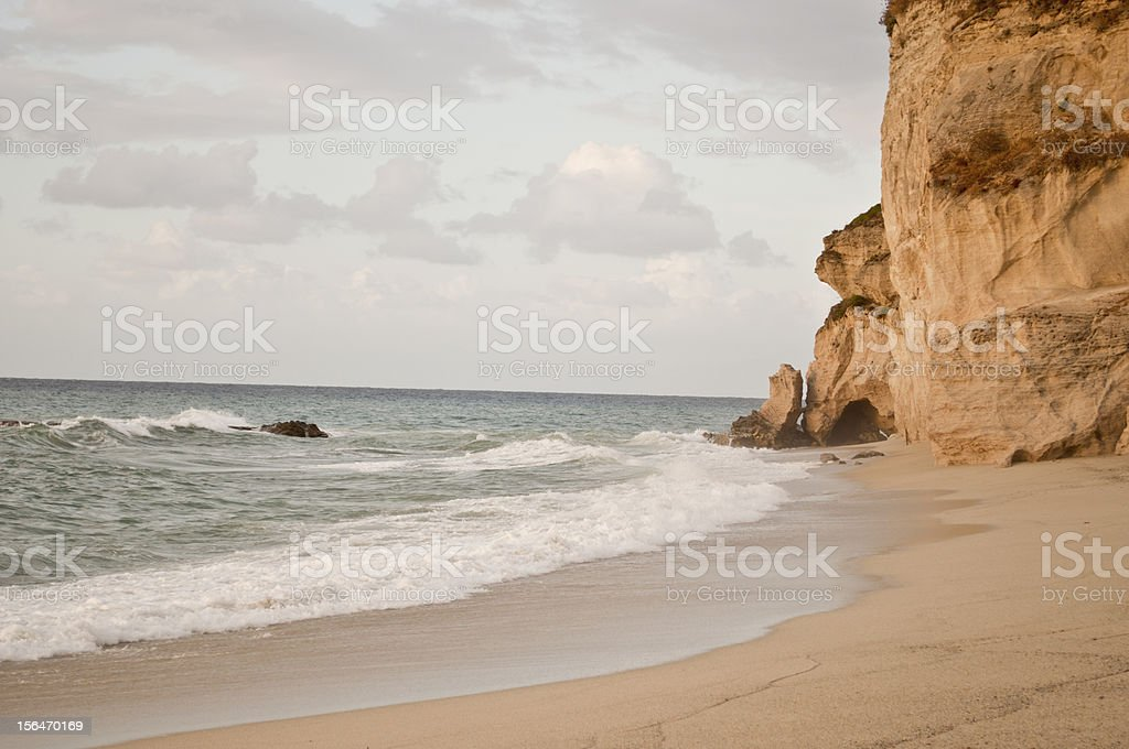 Sandy abandoned Beach with Rock royalty-free stock photo