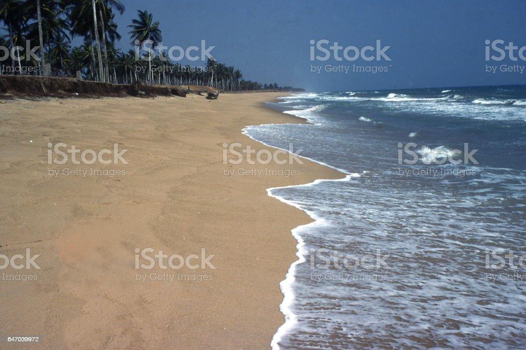 Sandy beach and ocean waves along coast near Lome Togo Africa stock photo