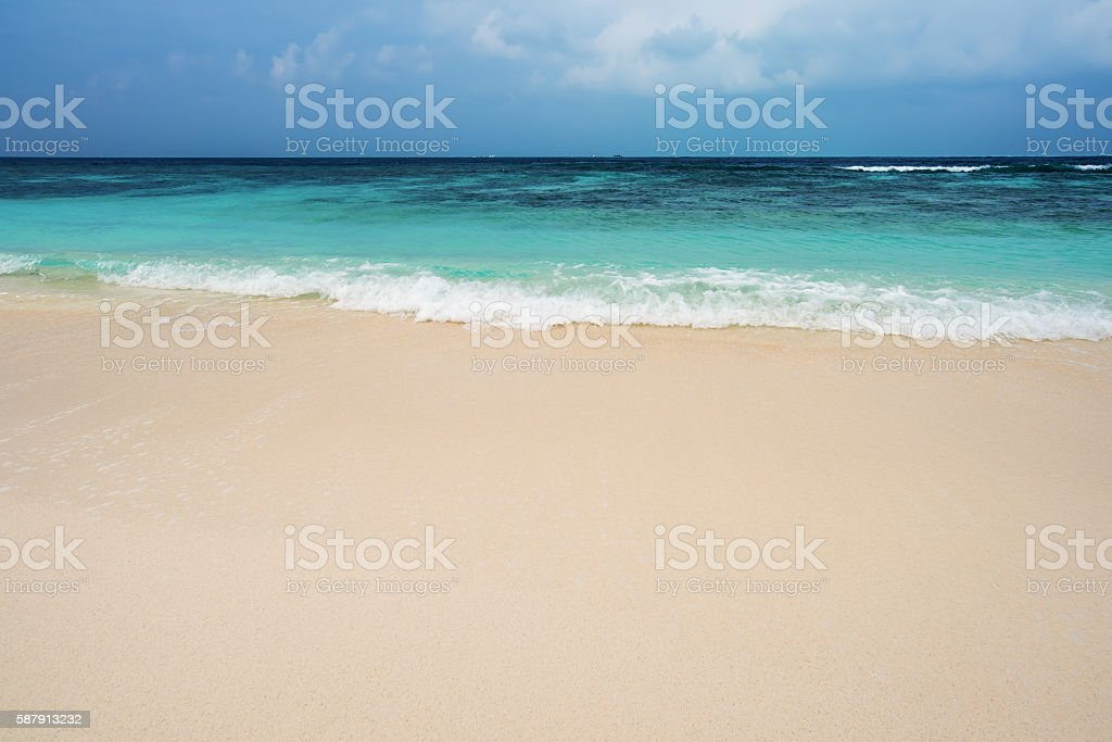 Sandy beach and sea stock photo