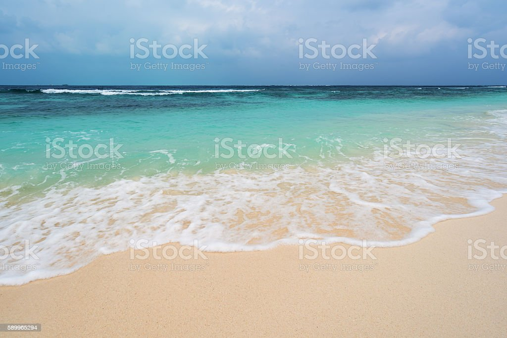 Sandy beach and stormy sky background stock photo