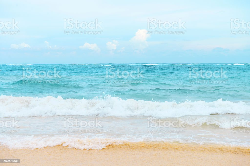 sandy beach and the sea close up stock photo