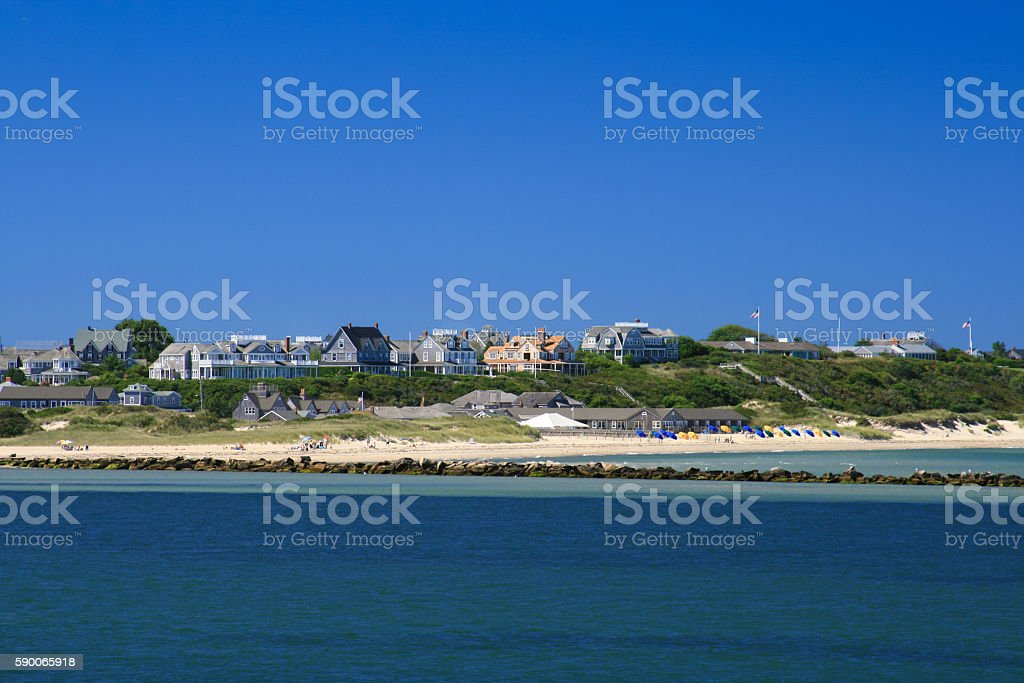 Sandy Beach and Waterfront Houses, Nantucket Island, Massachusetts. Blue sky. stock photo
