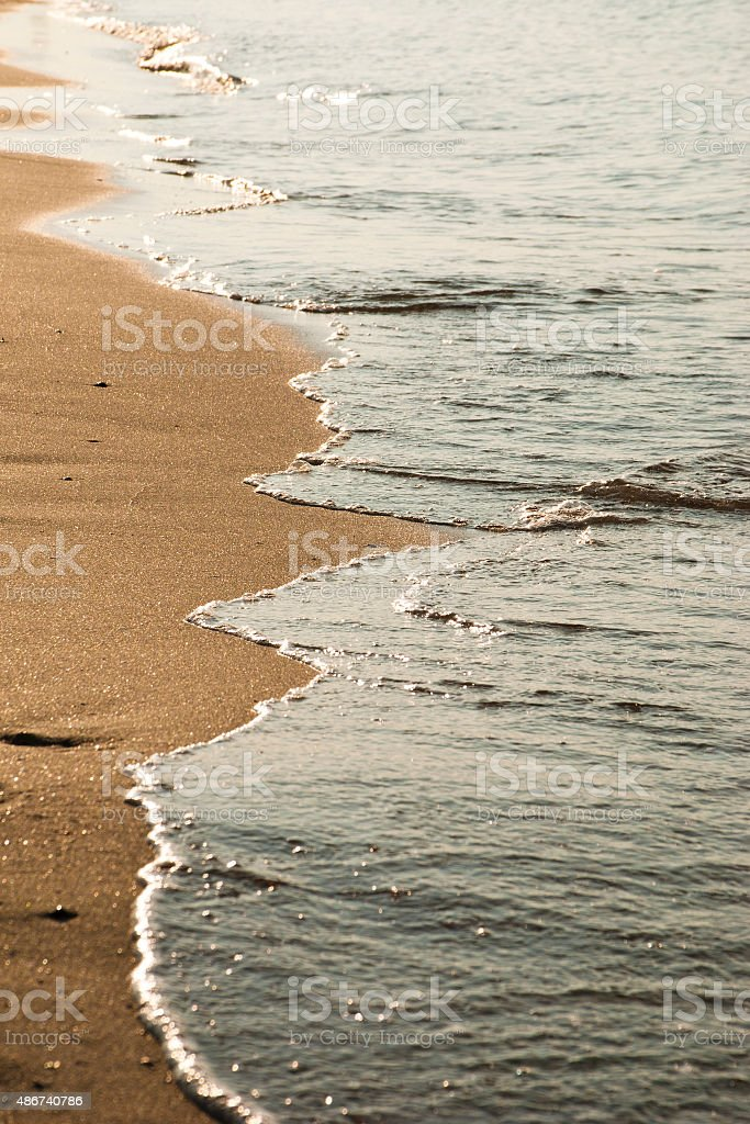 Sandy beach and waterline at dutch Northsea coast stock photo