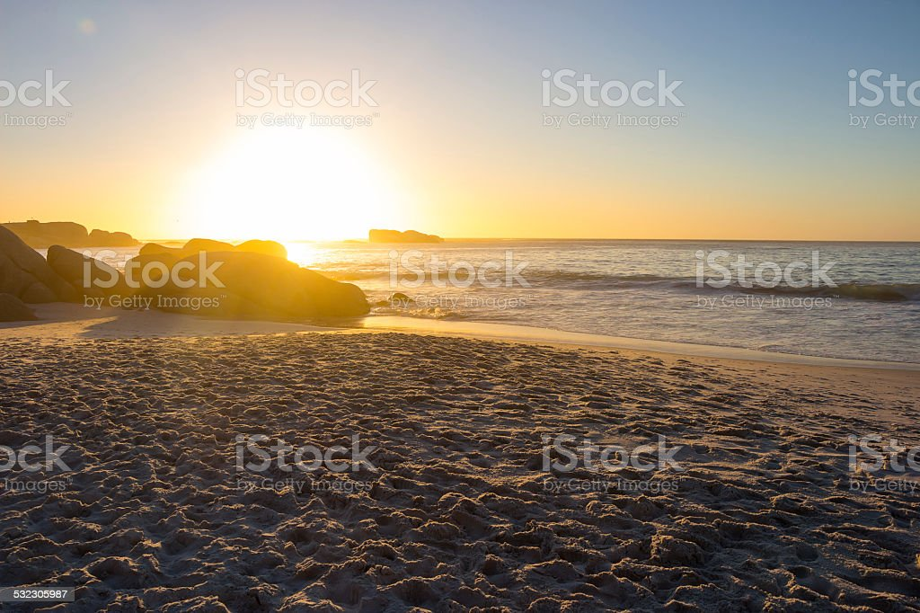 Sandy beach at sunset stock photo