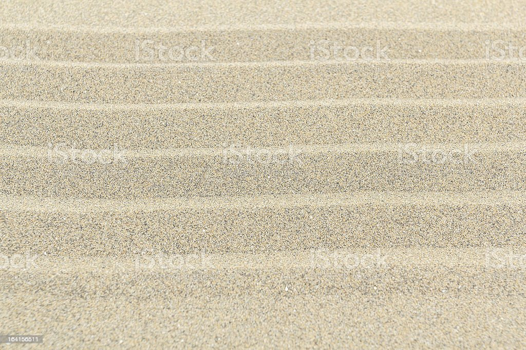 Sandy beach background texture with lines royalty-free stock photo
