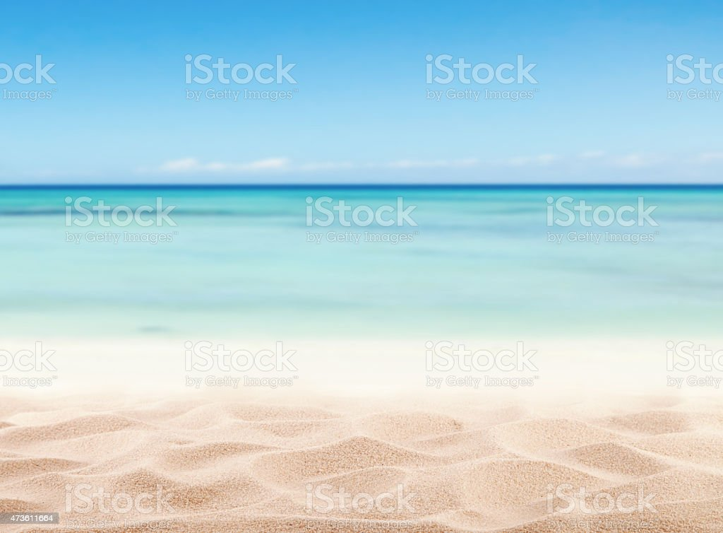 Sandy beach by the sea on a nice day stock photo