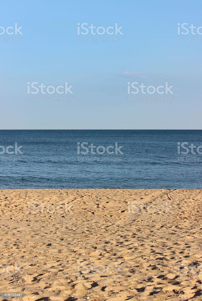 Sandy beach, sea and blue sky, seaside banner / summer holiday stock photo