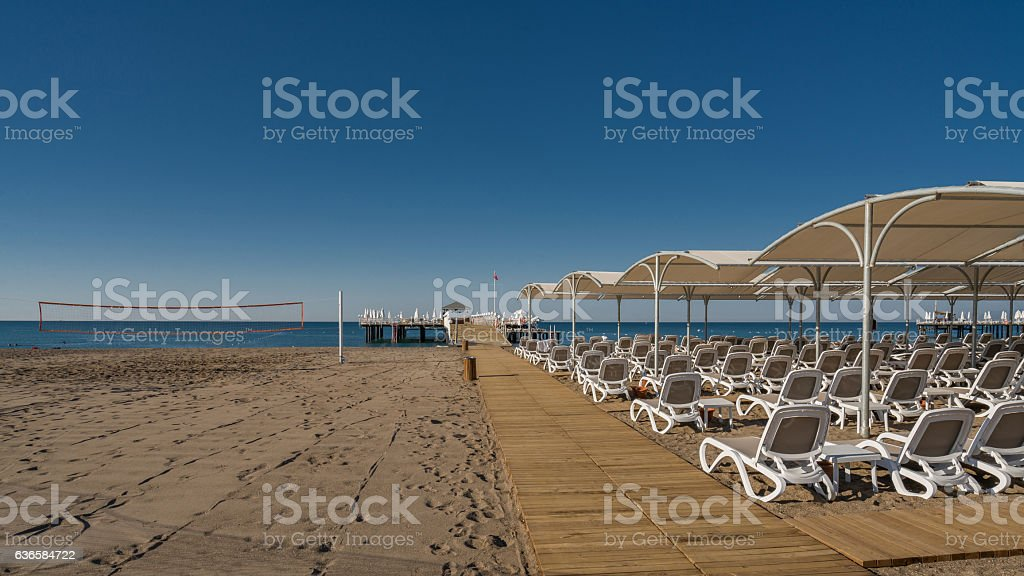 sandy beach sunbeds umbrellas stock photo