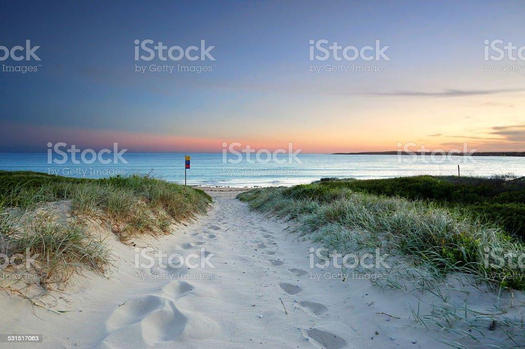 Sandy beach trail at dusk sundown Australia stock photo